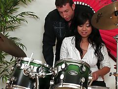 Sexy asian slut plays the drums