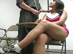 Cheerleader latina Laurie Vargas sucking cock behind college desk