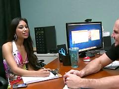 Sexy latina sitting behidn the desk