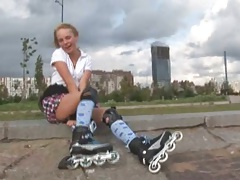 Outdoor public girl rollerblading with miniskirt from sarah Kimble