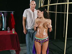 Oiled up latina Aleksa Nicole gets into a cage and touches guys dick